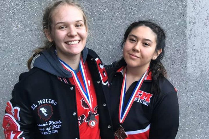 Lady wrestlers Hannah Ricioli and Lily Marrufo