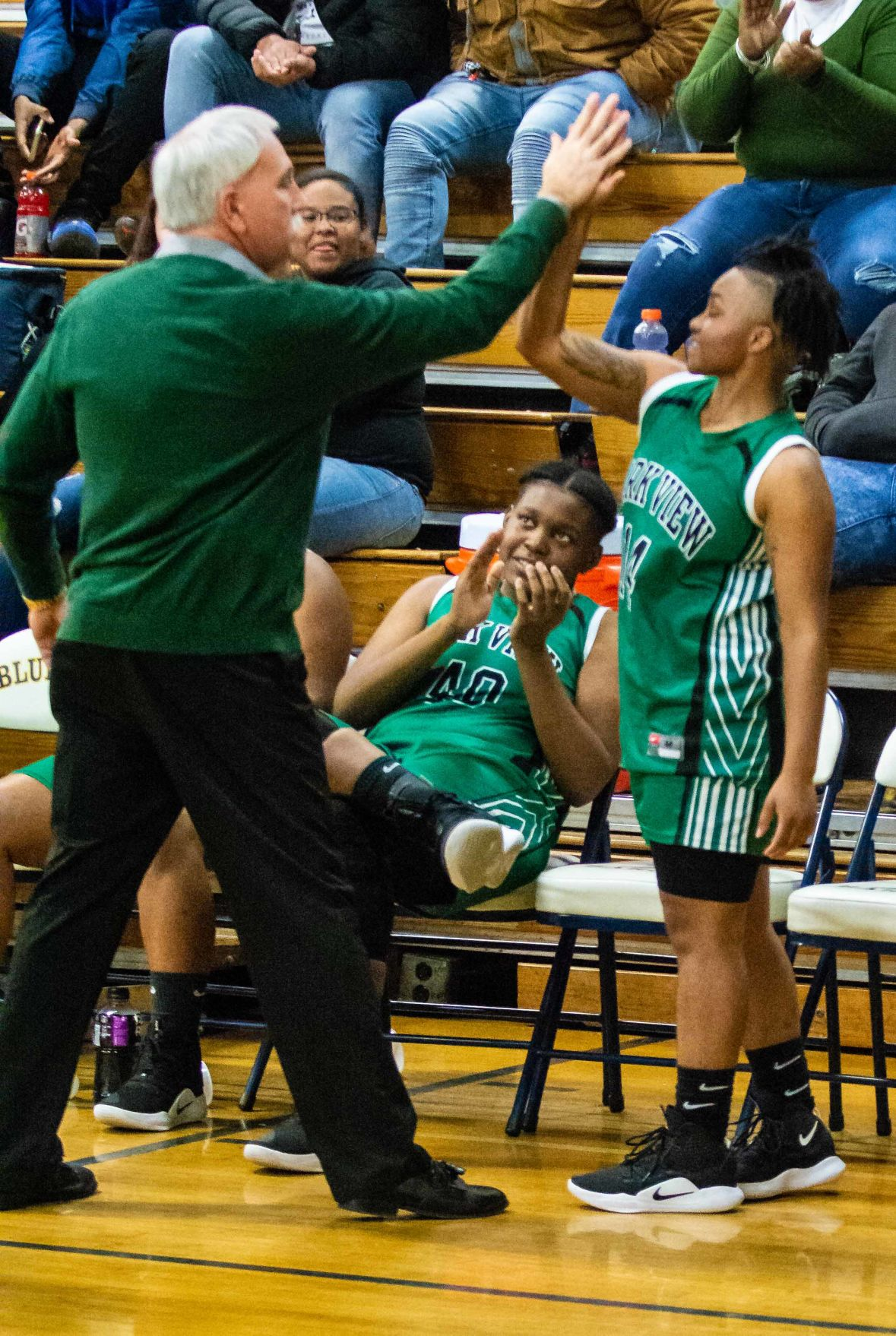 Park View HS Coach Michael Barmoy congratulates senior guard point Mikya Harrison after the announcement that she had just scored her 1,000th point in the Lady Dragons' 53-34 win over Bluestone HS in Skipwith on Friday night. (Dennis Smith)