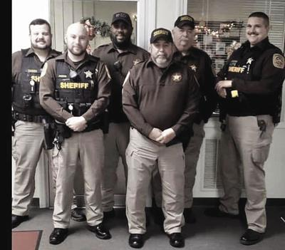 Sergeant Scott Mull will retire after 26 and a half years of service with the Mecklenburg County Sheriff's Office. Pictured in the front row from left to right: T.J. Jimmerson and Sergeant Scott Mull. Pictured in back row from left to right: Corporal Byrt Carnes, Jamie Thomas, Kenneth Johnson, and Calvin Jackson.