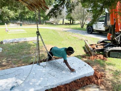 Family members join in on the effort to restore Westview Cemetery
