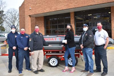 Springer contributes to Fire Department's Boat 7