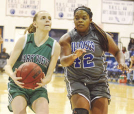 Park View's Sophie Janson looks to make a move as Brunswick's Desmyn Owens defends on this drive to the hoop in Lawrenceville last Wednesday night. (Dennis Smith)