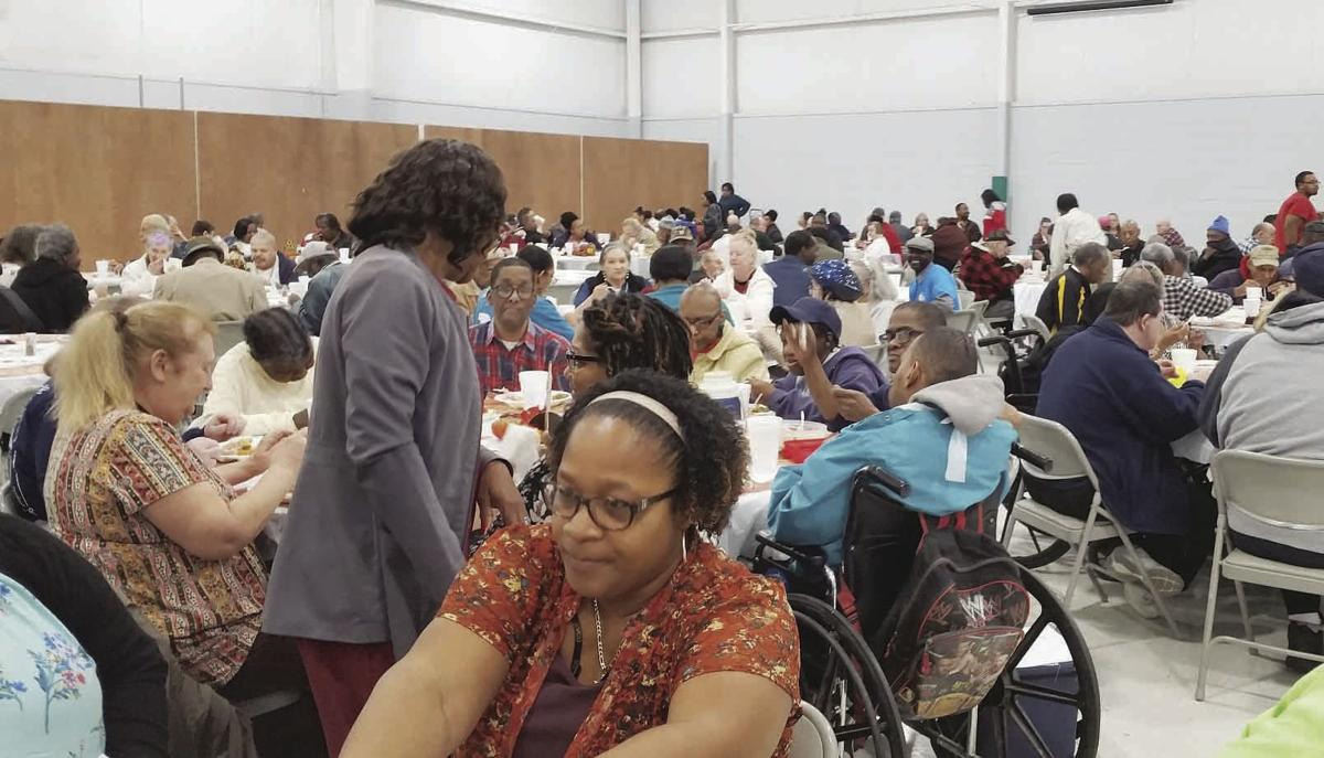 The crowd enjoyed a Thanksgiving meal and fellowship.