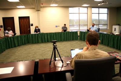 School directors blend in-person meeting with Zoom platform