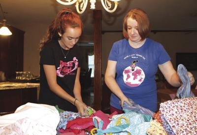 Girl Scout hosting dress workshops