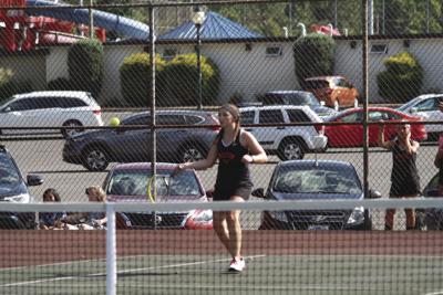 Milton rolls in tennis opener
