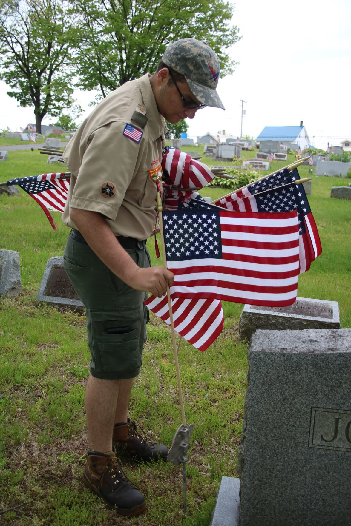 Scouts chip in to assist with flag placement ahead of Memorial Day