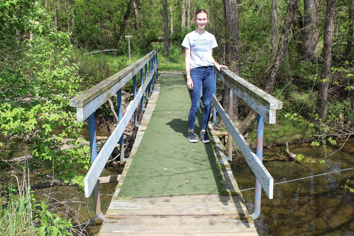 Girl Scout working to replace footbridge
