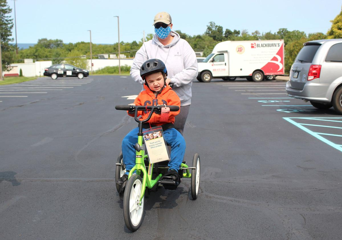 Children receive adaptive bikes, strollers
