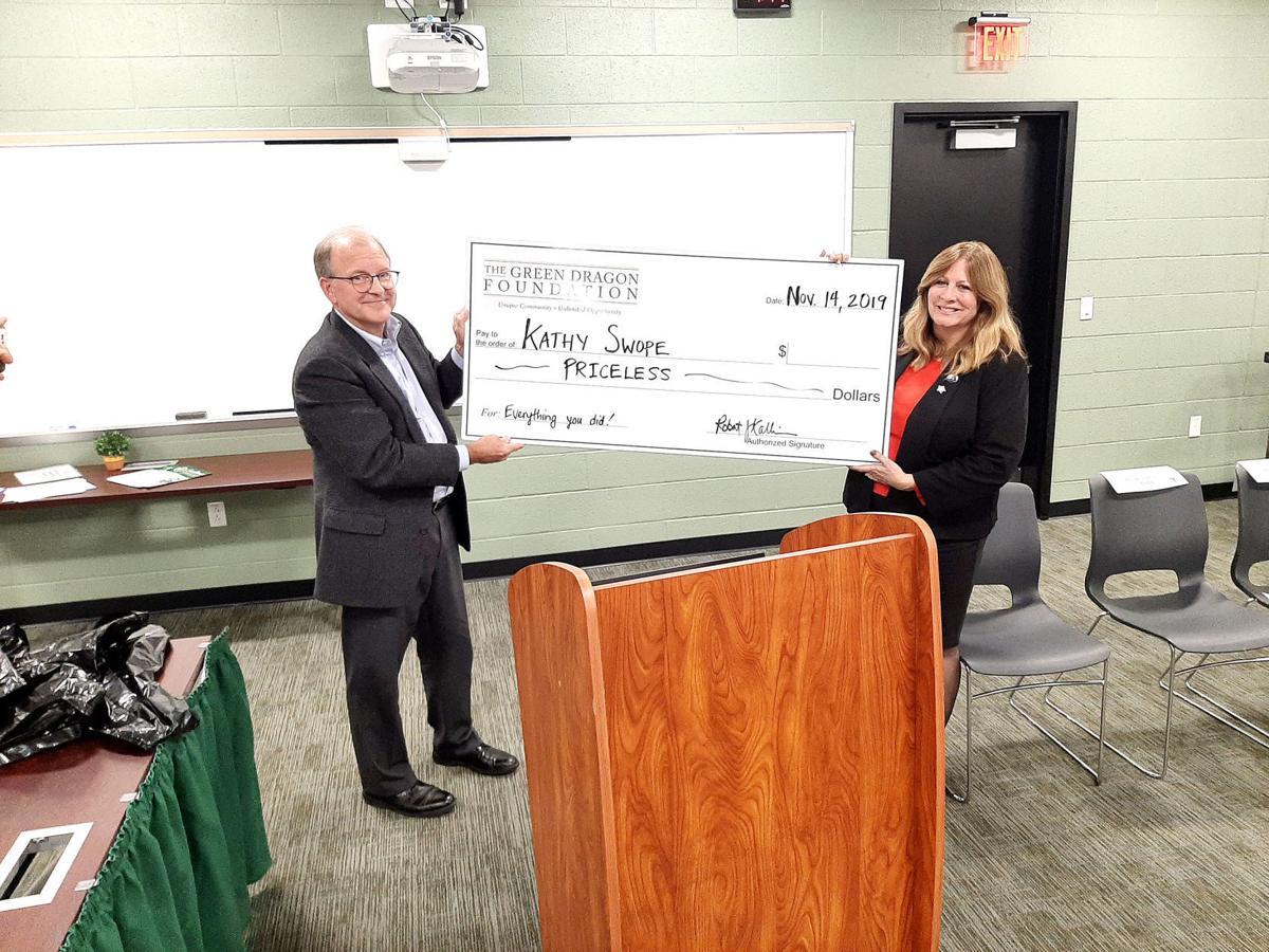 Swope honored upon last meeting of final term