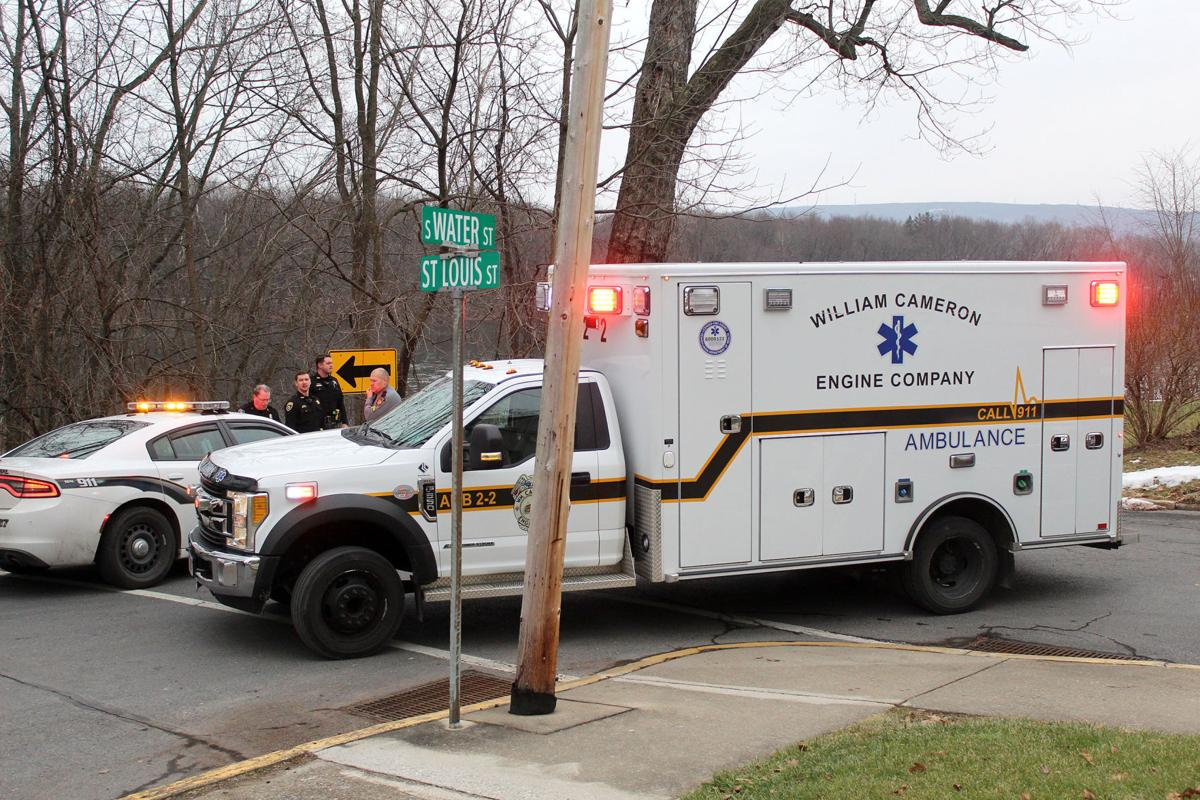 Police, bystander, pull woman from river