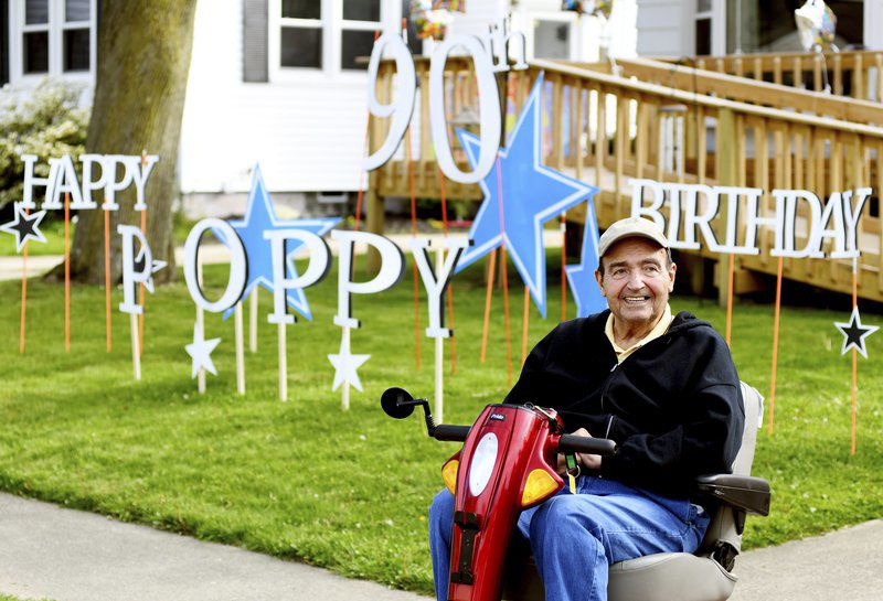 Community drives by to honor 90-year-old man on his birthday