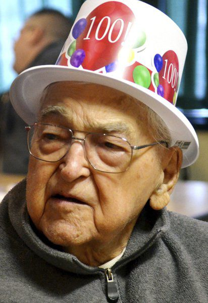 Ross Tittle surrounded by family and friends for 100th birthday