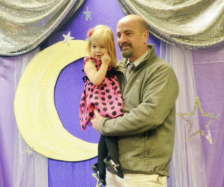 Library draws young families for 'Baby Prom'