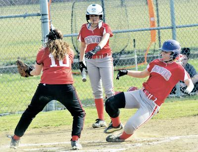 low priced 10723 872b8 Edgewood SB. MERCEDES BURNS of Edgewood slides safely under the tag of  Alexis Bayus of Struthers to score a run during an All-American Conference  clash ...
