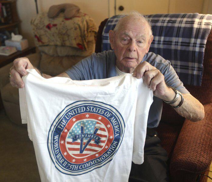 WW II vet honored; misses trip to Hawaii