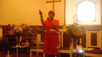 Danita Harris speaks at Hiawatha Church