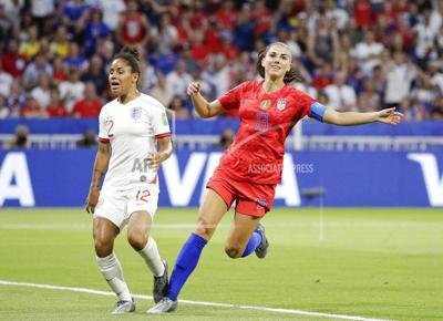 Morgan scores and Naeher saves in 2-1 victory over England