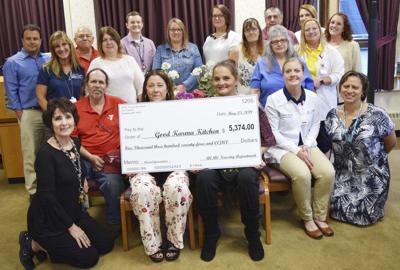 ACMC nurses present $5,374 check to Good Karma Kitchen