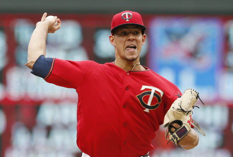 Santana's slam in 10th gives Indians 7-3 win, tie with Twins