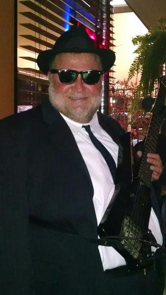 Andover village solicitor is banker by day, bassist by night