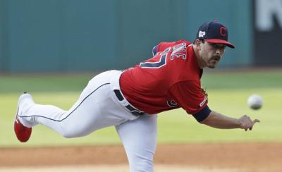 Minor strikes out 7 in 7 innings, Rangers beat Indians 1-0