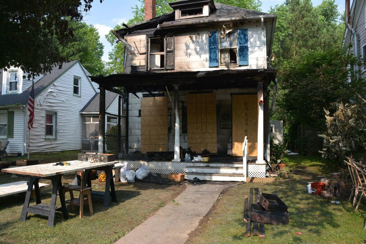 Investigators determine house fire originated in front porch soffit