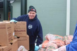 Volunteers come together to provide food