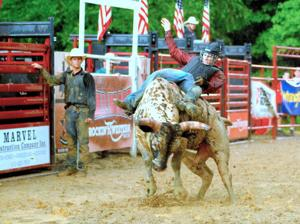 Muddy bullriders roll at the Talbot County Fair