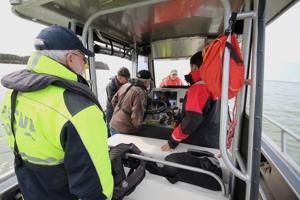 Squad upgrades sonar equipment on rescue boat