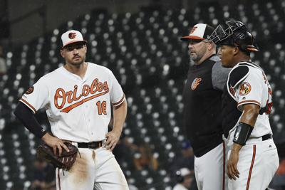 Hill shaky in return, but Dodgers beat O's