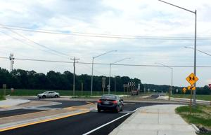 Roundabout opens at Route 16 and Woods Road