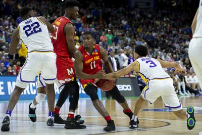 Last-second shot by Waters thwarts Maryland's second-half rally