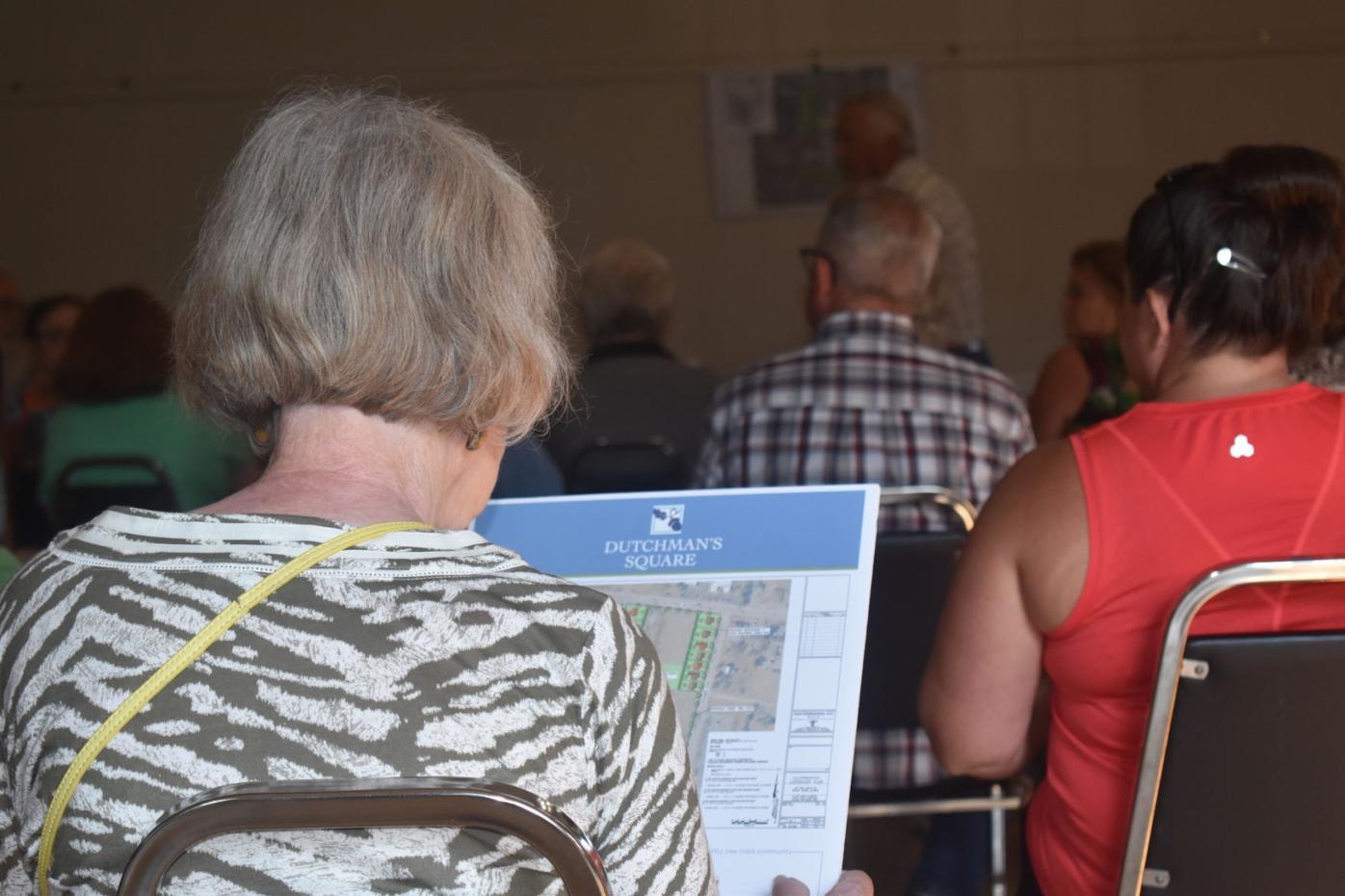 Resident looking at design plan