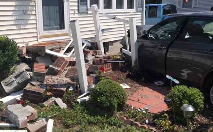 Car hits house