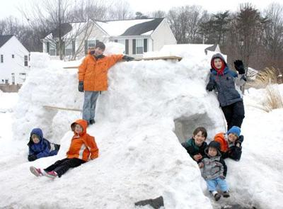 4fc96c7a9c90 Neighborhood children build snow fort