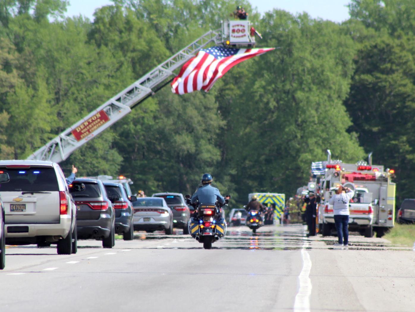 Heacook motorcade under flag