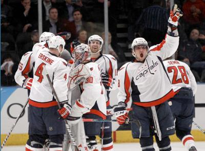 e59f618325f Teammates watch as Washington Capitals left wing Alex Ovechkin (8)  celebrates after the Capitals defeated the New York Rangers 4-3 in the  second overtime of ...