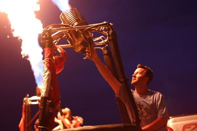 'Night Glow' hits weather snag, spectators still feel the heat
