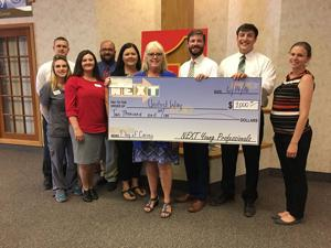 NEXT Young Professionals donate to United Way