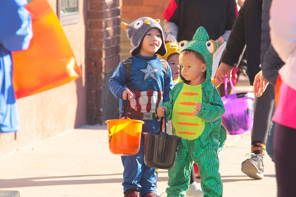 Youngsters flock to downtowns for trick or treating