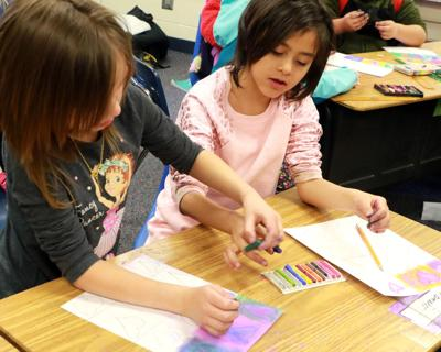 Northfield students create Kandínsky-inspired hearts.