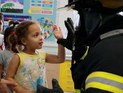 FIRE EDUCATION Learning fire safety Scottsbluff firefighters visit Bearcub Preschoolers.