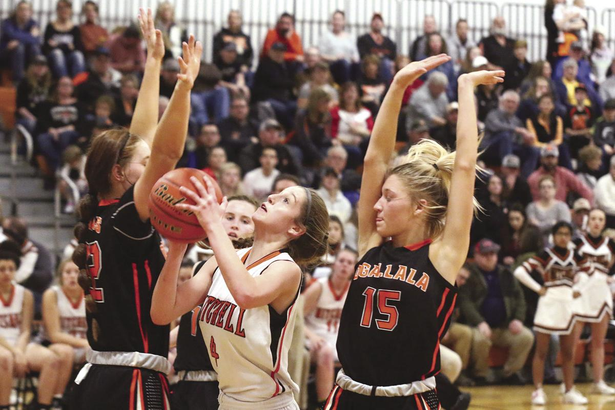 Mitchell boys hold off Ogallala, Ogallala girls pick up win