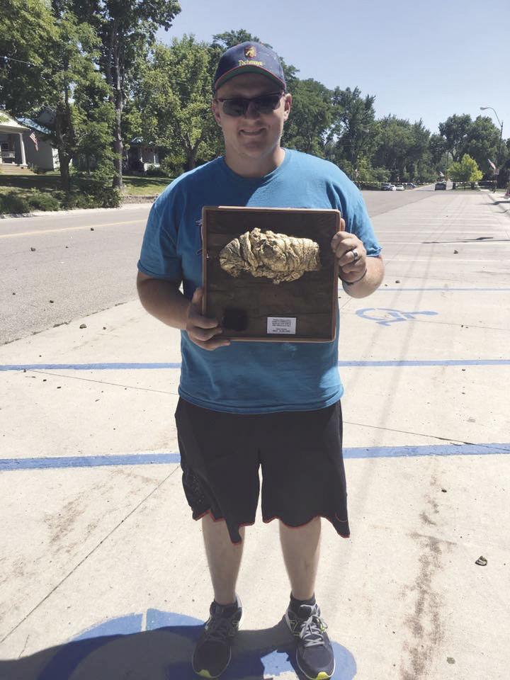 Dylan Brant holding trophy