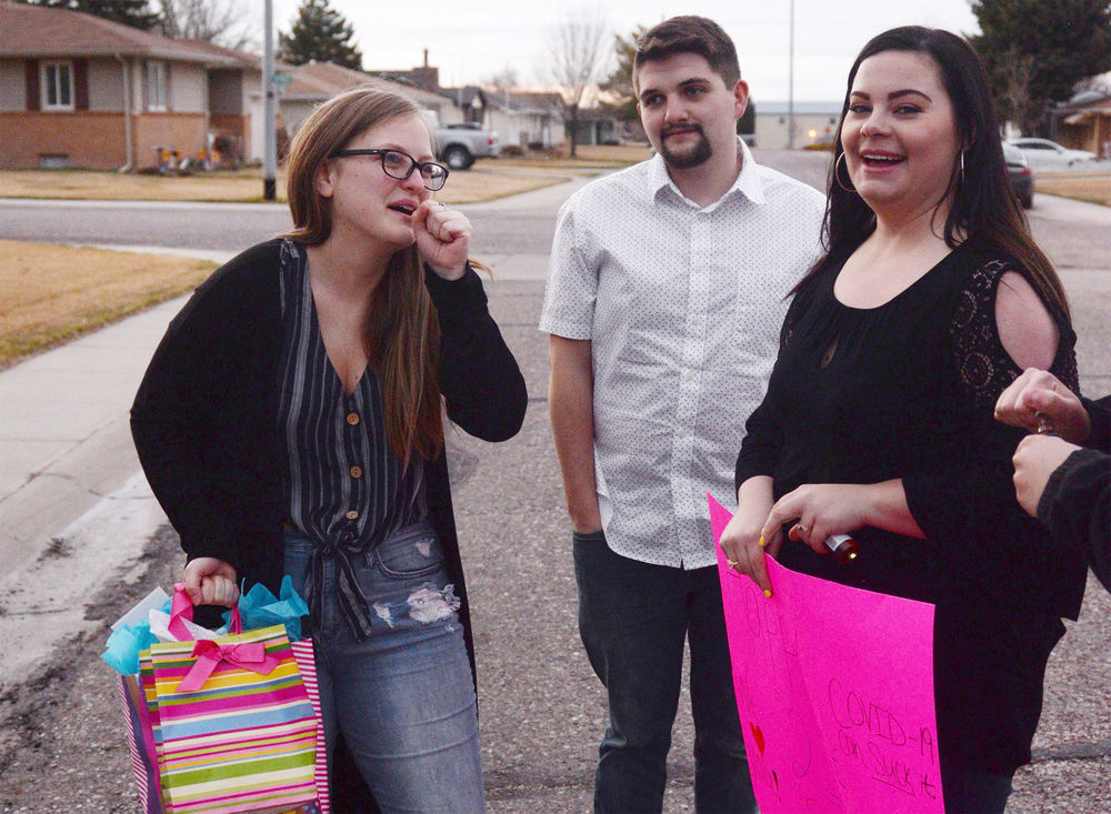 Friends help 21-year-old celebrate birthday with a 'drive-by party'