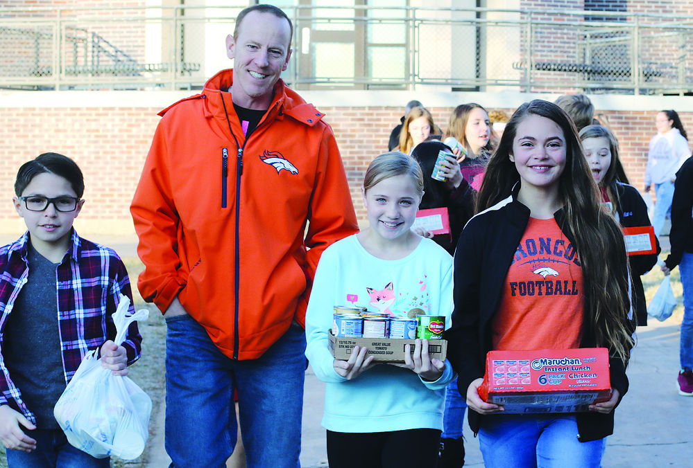 BMS students collect and deliver food for holiday collection programs