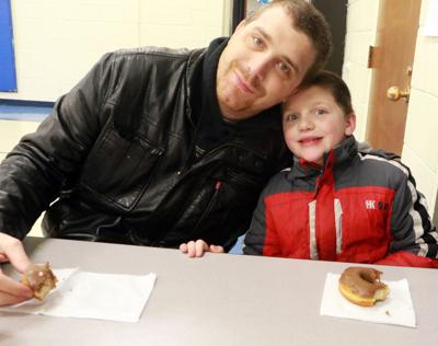 Bonding over doughnuts: Kids enjoy time with dad at Geil Elementary