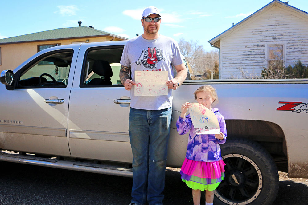 Teachers surprise kids with drive-by parade