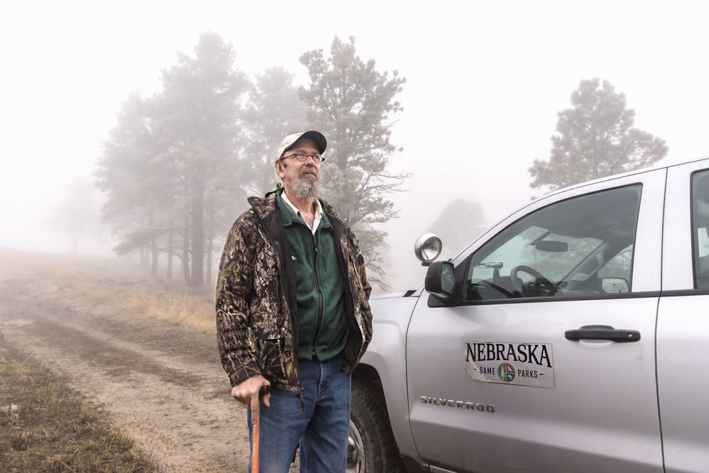 Biologist Dean Studnicka surveys deer, elk, bighorns and other wild residents that roam the Pine Ridge